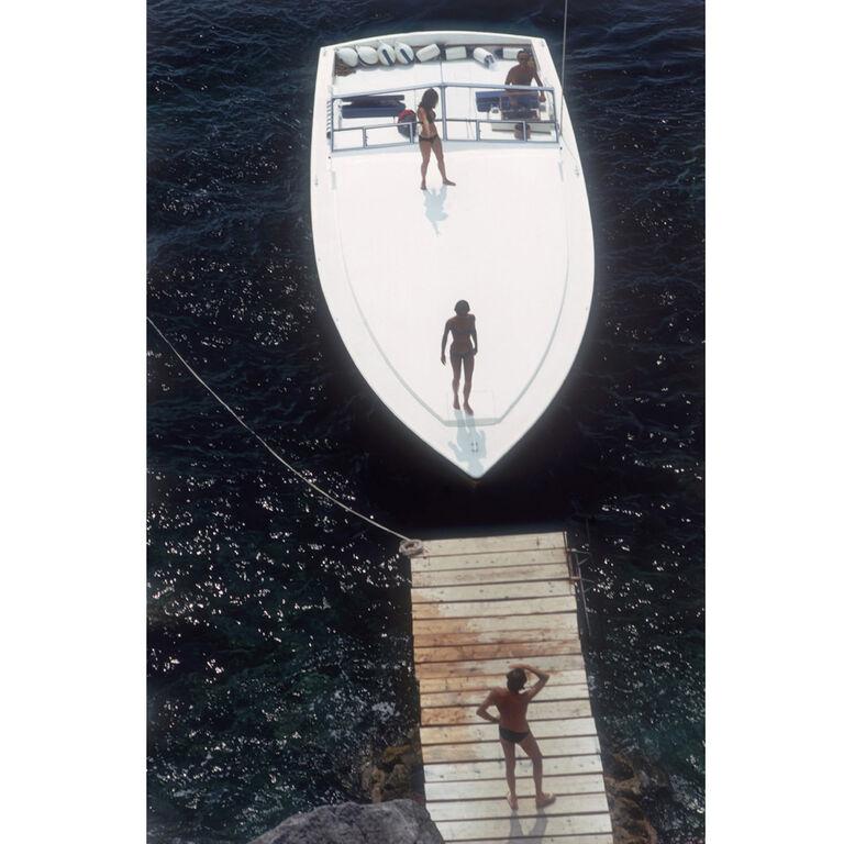 """Slim Aarons - Slim Aarons """"Speedboat Landing """" Photograph"""